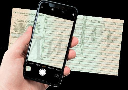 Bild von Smartphone und Fahrzeugschein